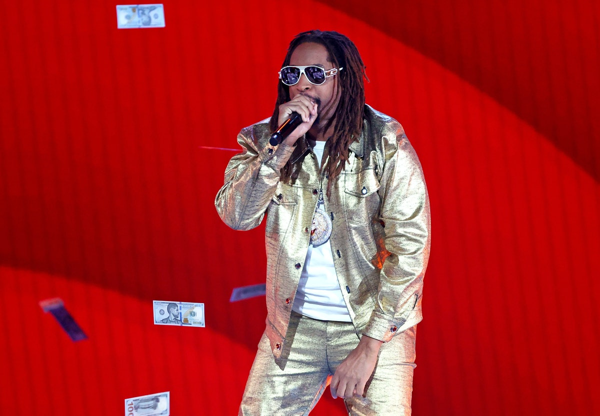 Lil Jon performing on stage in a gold outfit