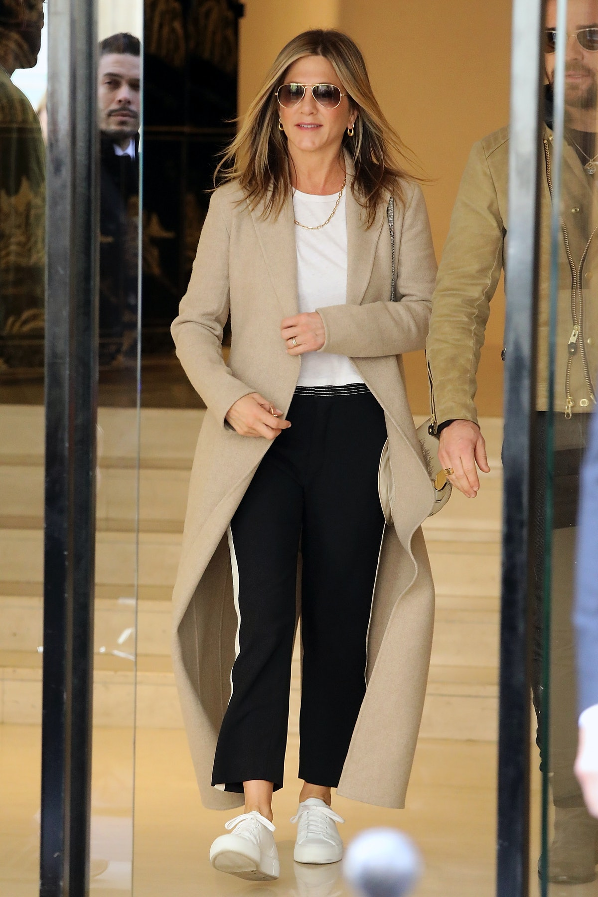 Jennifer Aniston wears Celine Box crossbody bag while leaving a Chanel store on April 12, 2017 in Pa...