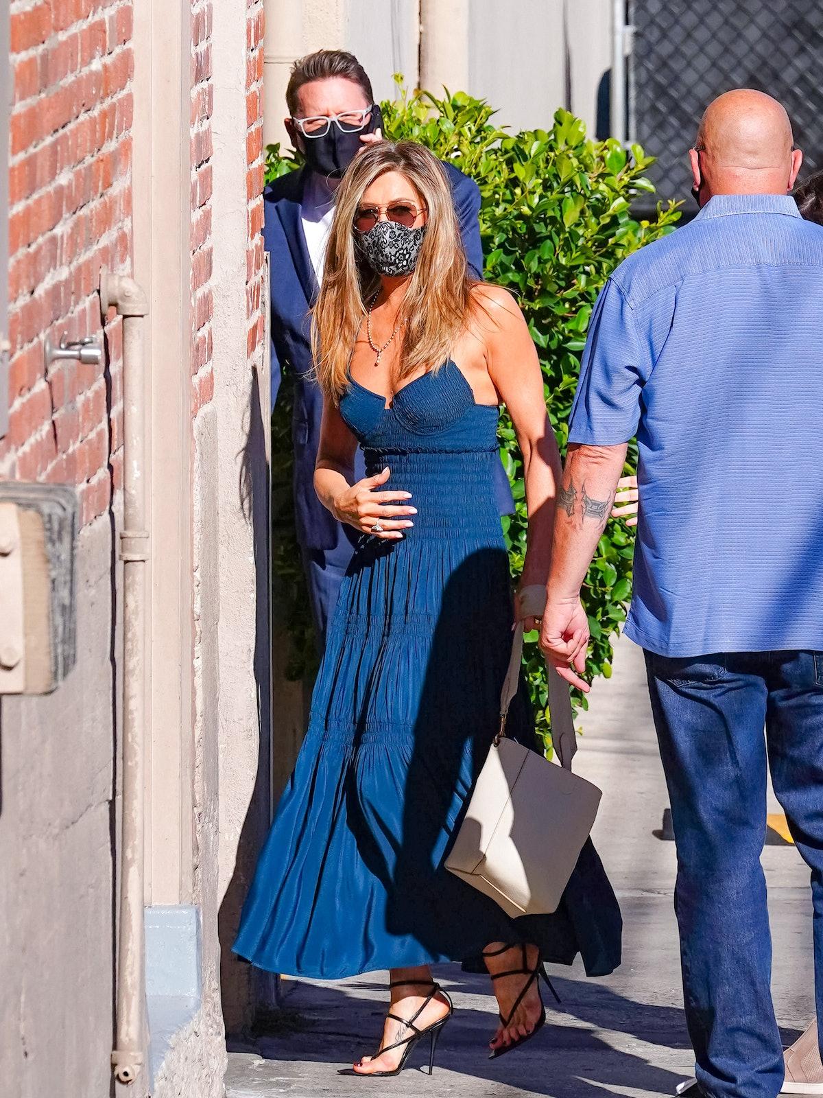Jennifer Aniston wears white Celine small Sangle bag while arriving at  'Jimmy Kimmel Live!' on Sept...