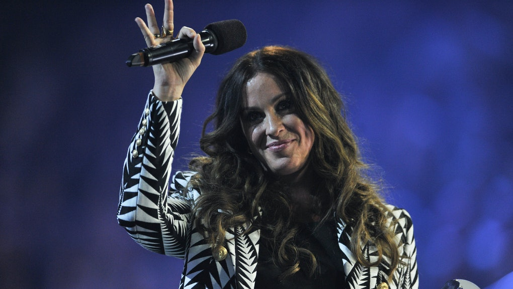 HAMILTON, ON - MARCH 15:  Alanis Morissette is presented an award at the 2015 JUNO Awards at FirstOn...