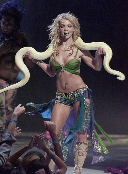 Britney Spears holding a snake on stage at the 2001 MTV VMAs.