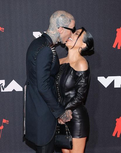 Kourtney Kardashian and Travis Barker take any chance they get to share PDA.