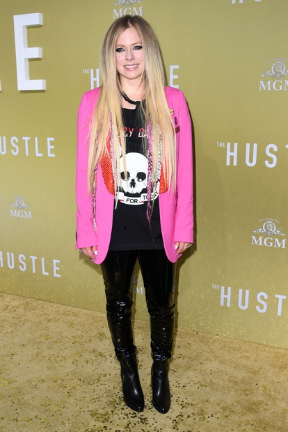 """Canadian singer Avril Lavigne arrives to the premiere of """"The Hustle"""" at the Arclight Cinerama Dome ..."""