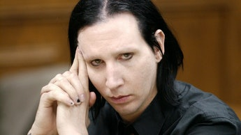 Brian Warner, better known as Marilyn Manson, listens during his preliminary examination 28 December...