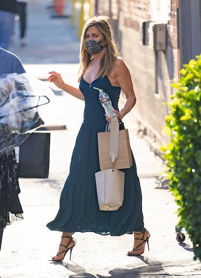 "Jennifer Aniston wears white Celine Small Sangle Bucket Bag  while outside of ""Jimmy Kimmel Live"" on..."