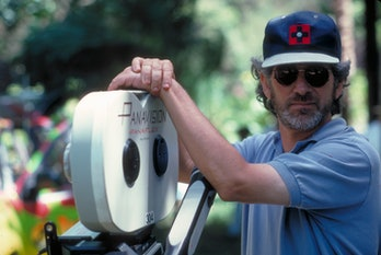 American director Steven Spielberg poses with a Panaflex camera on the set of the film 'Jurassic Par...