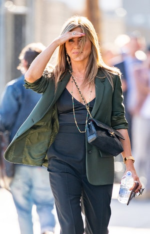 Jennifer Aniston  wears black quilted Chanel Classic Flap Bag outside at 'Jimmy Kimmel Live' on May ...