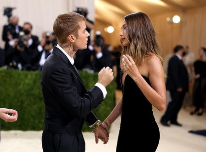 NEW YORK, NEW YORK - SEPTEMBER 13: Justin Bieber consoles wife Hailey Baldwin at The 2021 Met Gala w...