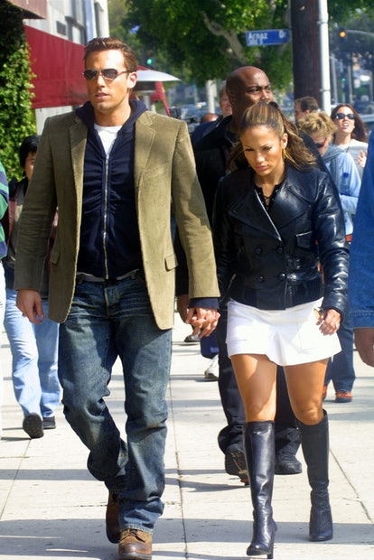 """Dress up as Jennifer Lopez and Ben Affleck on set for the """"Jenny from the OR"""" Musical clip."""