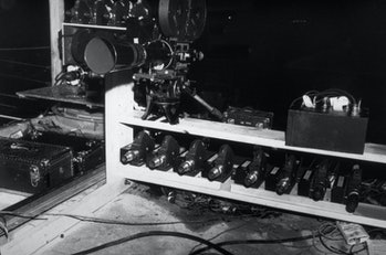 A collection of movie cameras waits ready to photograph the Trinity nuclear weapon test, near Los Al...