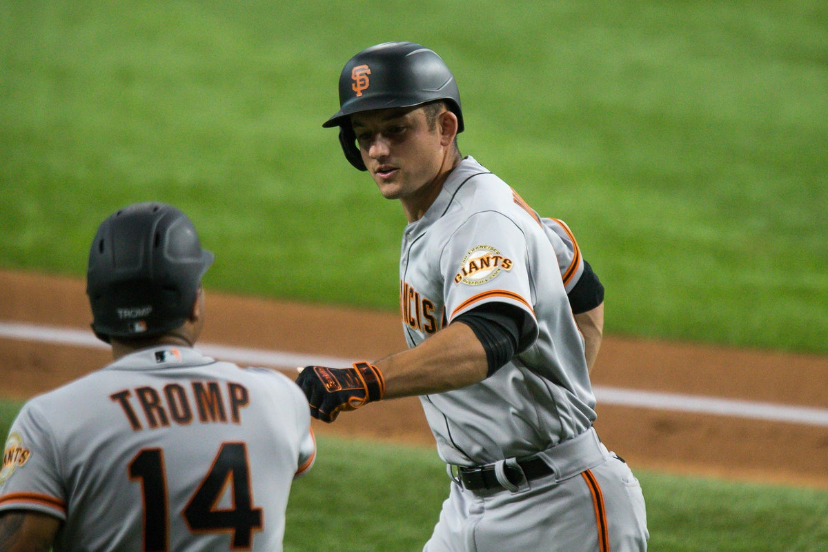 ARLINGTON, TX - JUNE 09: San Francisco Giants Infield Jason Vosler (32) is congratulated after his h...