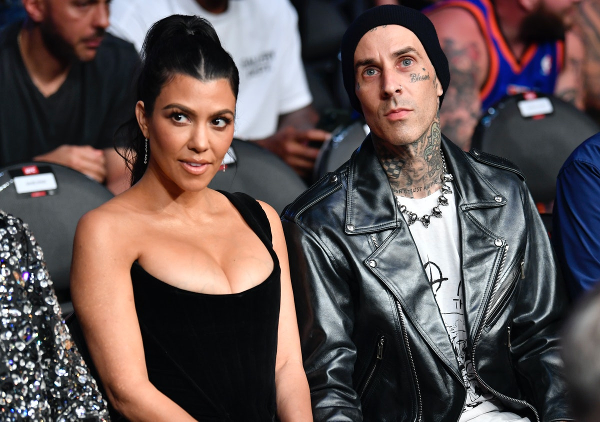 Kourtney Kardashian and Travis Barker attend the UFC 264 event in July of 2021, just before vacation...