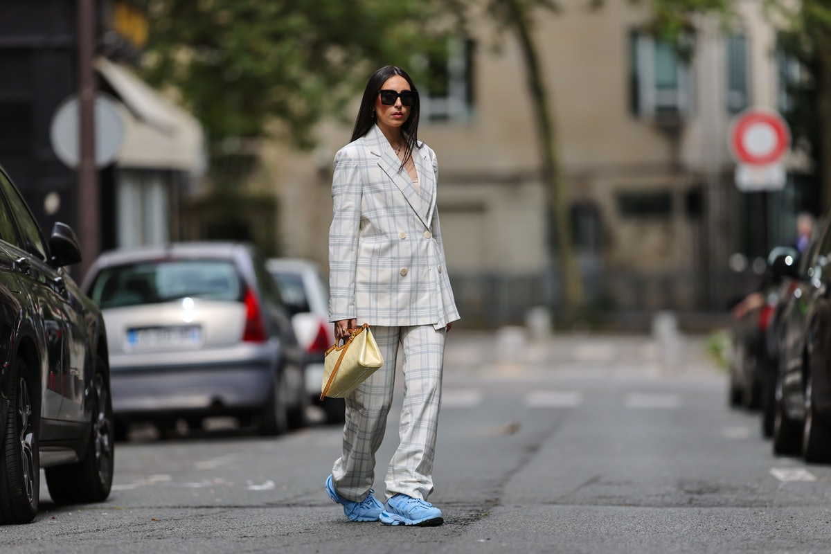 A fashion influencer demonstrates how to wear sneakers in a business casual environment