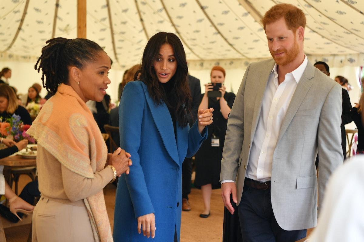 LONDON, ENGLAND - SEPTEMBER 20: Meghan, Duchess of Sussex (C) arrives with her mother Doria Ragland ...