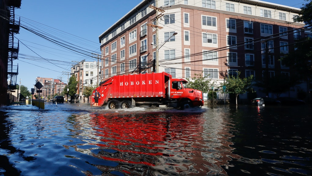 HOBOKEN, NJ - SEPTEMBER 2: A sanitation truck drives through a flooded street the morning after the ...