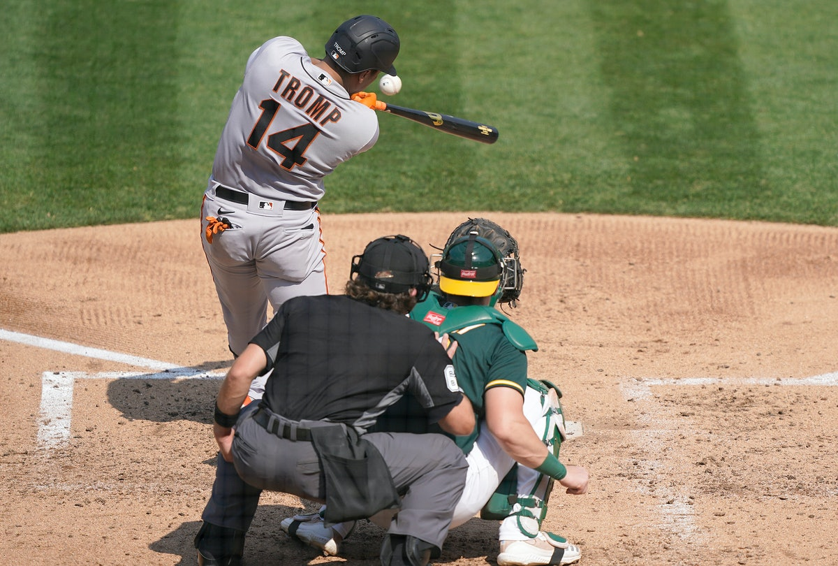 OAKLAND, CALIFORNIA - SEPTEMBER 20: Chadwick Tromp #14 of the San Francisco Giants bats against the ...