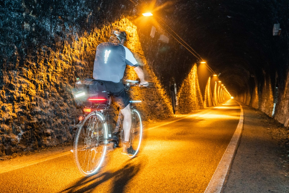01 September 2019, Hessen, Hoifbieber: A cyclist is on his way through the Milseburg Tunnel in the l...