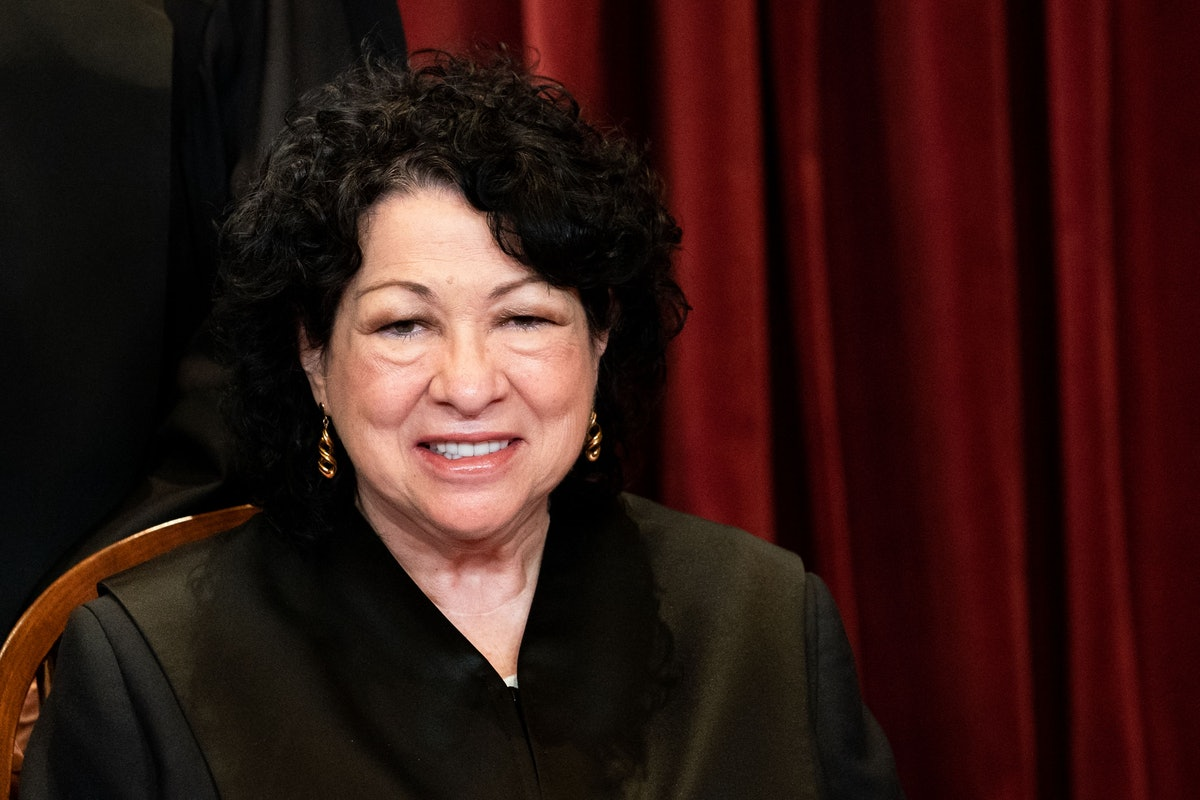 Associate Justice Sonia Sotomayor sits during a group photo of the Justices at the Supreme Court in ...
