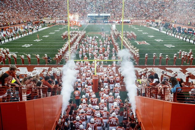 Texas Longhorns take the field before the game against the Rice Owls at Darrell K Royal-Texas Memori...