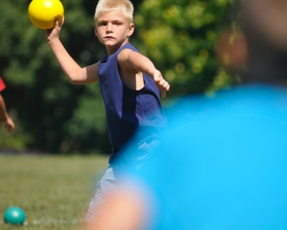 Michael R. Lee, 7, of Lower Heidelberg Township, plays dodgeball during a county playground event Fr...