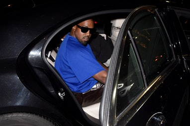 LONDON, ENGLAND - OCTOBER 09: Kanye West arrives at Bottega Veneta Salon 01 London collection presen...
