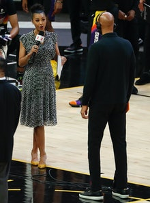 PHOENIX, ARIZONA - JULY 06: Reporter Malika Andrews from ESPN talks with Monty Williams of the Phoen...