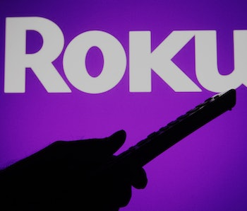 UKRAINE - 2021/07/04: In this photo illustration a Roku logo is seen on a screen with a silhouette o...