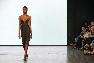 LONDON, ENGLAND - SEPTEMBER 17: A model walks the runway at the Nensi Dojaka show during London Fash...