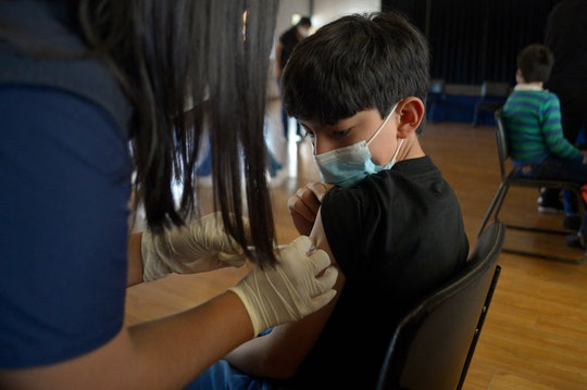 A boy receives the first dose of the Pfizer/BioNTech COVID-19 vaccine at a private school in Quito o...