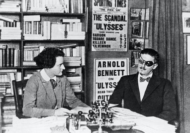 Author of Ulysses James Joyce and his publisher Sylvia Beach in an office in Paris.