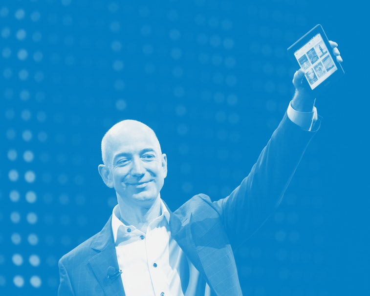 SANTA MONICA, CA - SEPTEMBER 6:  Amazon CEO Jeff Bezos holds a new front-lit Kindle Paperwhite 3G re...