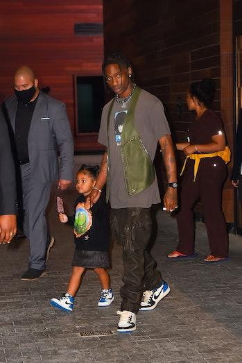 NEW YORK, NEW YORK - JUNE 15: Travis Scott and daughter Stormi Webster seen in Manhattan on June 15,...