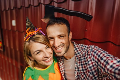 A young couple takes a fun selfie to post on Instagram for Halloween.