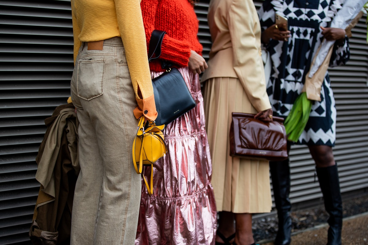 LONDON, ENGLAND - SEPTEMBER 19: Guests seen wearing bags outside Rejina Pyo during London Fashion We...