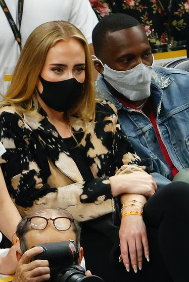 PHOENIX, ARIZONA - JULY 17: Singer Adele looks on next to Rich Paul during the first half in Game Fi...