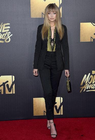 BURBANK, CA - APRIL 09:  Model Gigi Hadid arrives at the 2016 MTV Movie Awards at Warner Bros. Studi...