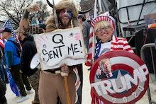 "WASHINGTON, D.C. - DECEMBER 12: Trump supporter and QAnon follower Jake ""The Q Shaman"" Angeli attend..."
