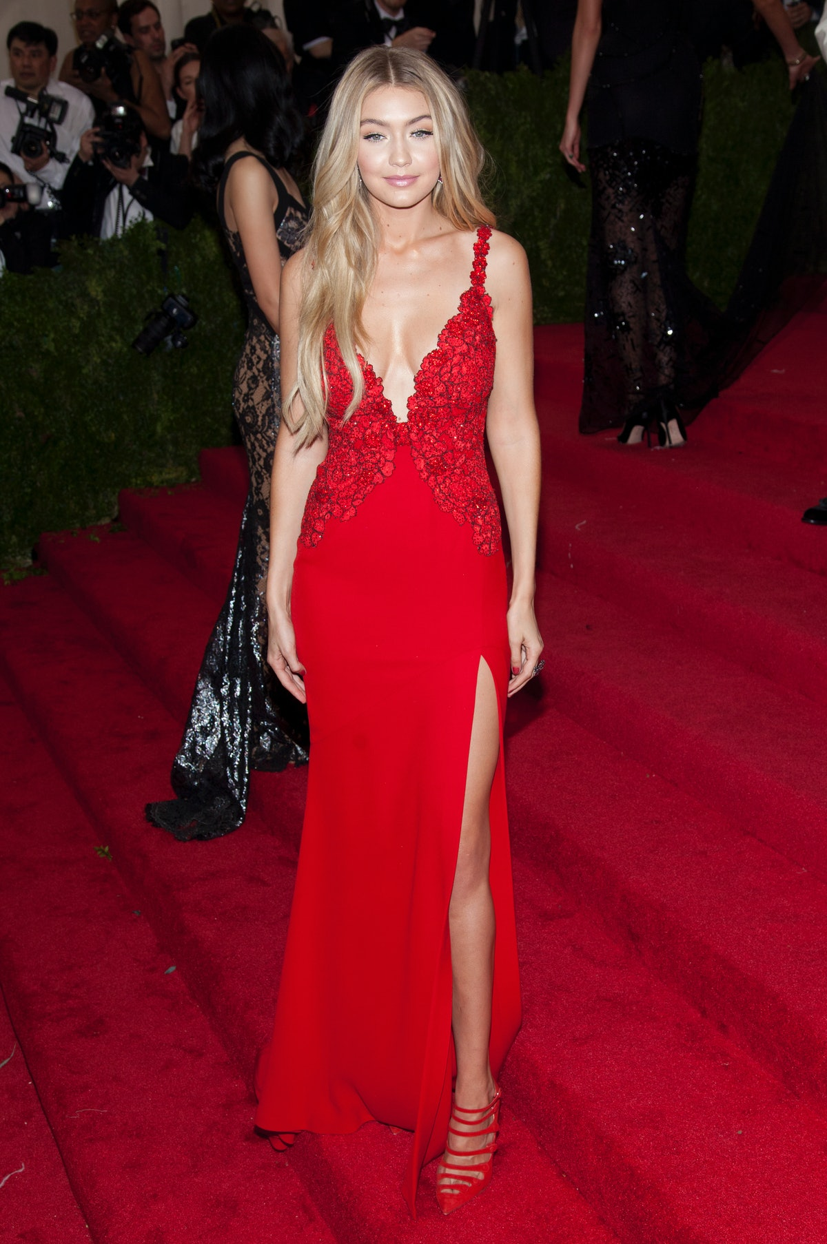 """Gigi Hadid attends """"China: Through the Looking Glass"""" 2015 Costume Institute Benefit Gala - red carp..."""
