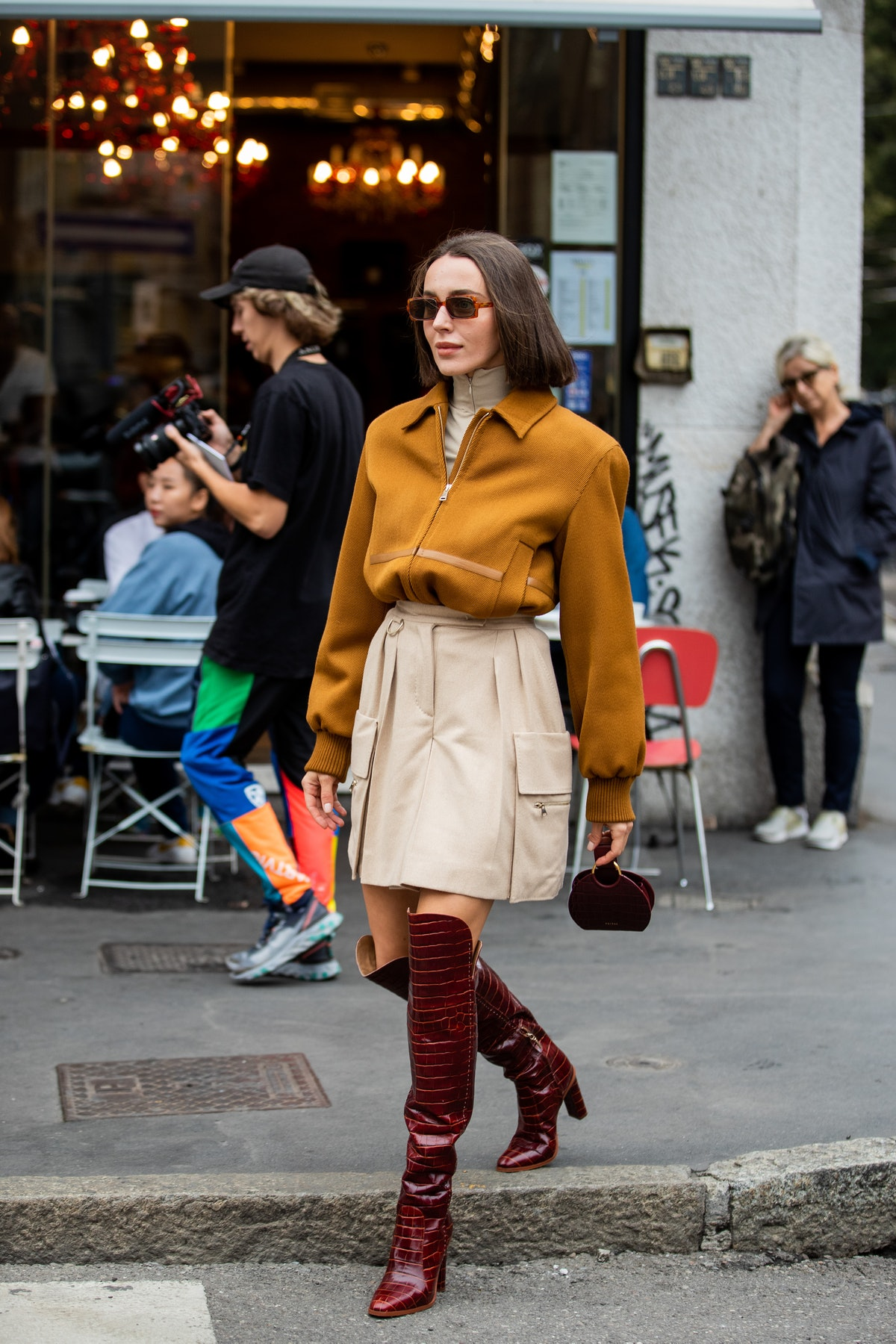 Tall boots with a mini skirt.