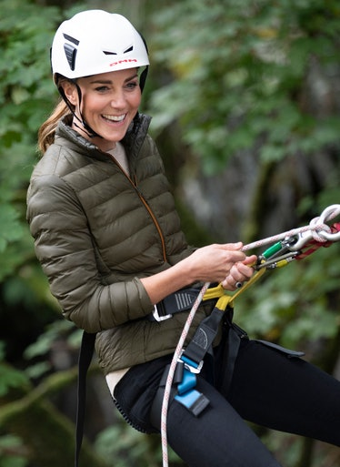 Britain's Catherine, Duchess of Cambridge, uses climbing equipment as she visits Royal Air Force (RA...