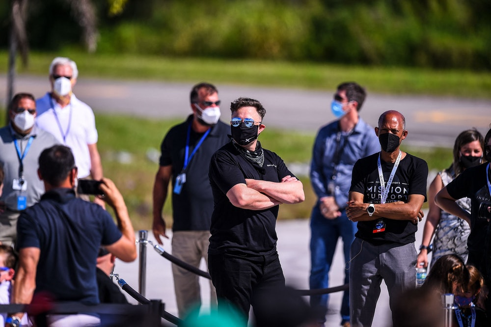 SpaceX CEO Elon Musk (C) looks on during the Inspiration4 crew send off at NASAs Kennedy Space Cente...