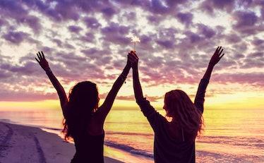Cute happy teen girls on the beach