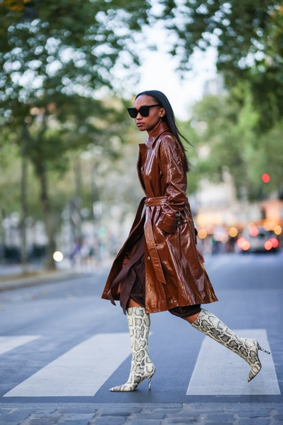 Tall animal print boots with a leather trench coat.
