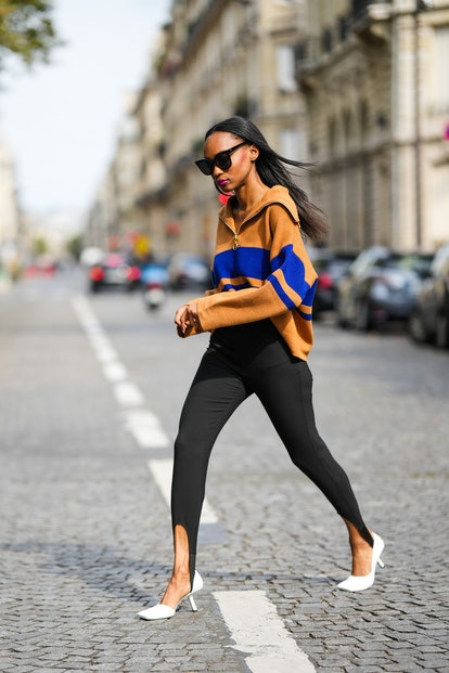 Stirrup leggings styled with a sweater.