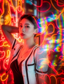 Young woman surrounded by neon lights, thinking about how Mercury retrograde fall 2021 ending will a...