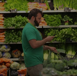 BOSTON, MA - MAY 28: Owen Amsler, an Instacart shift captain, shops for a customer in the Whole Food...