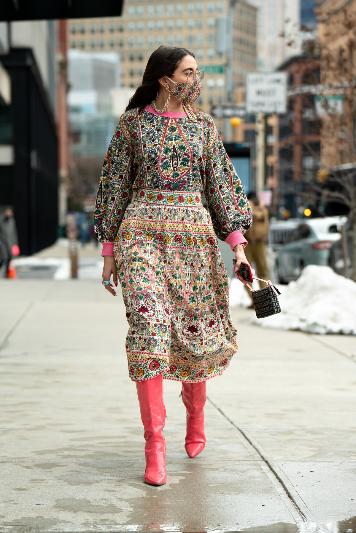 A printed dress with colorful tall boots.