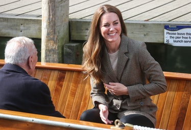 LOW WRAY, ENGLAND - SEPTEMBER 21: Catherine, Duchess of Cambridge reacts as the boats horn sounds ah...
