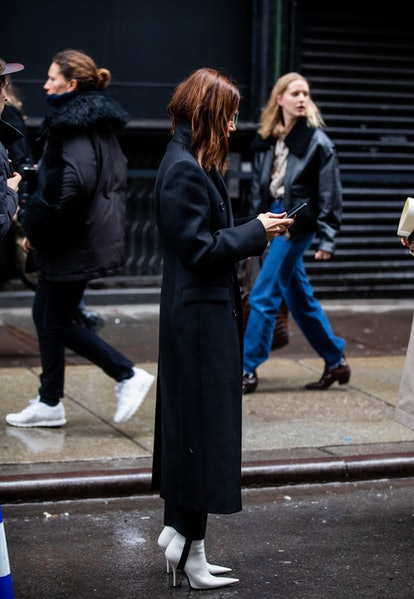 Black stirrup leggings with white heels.