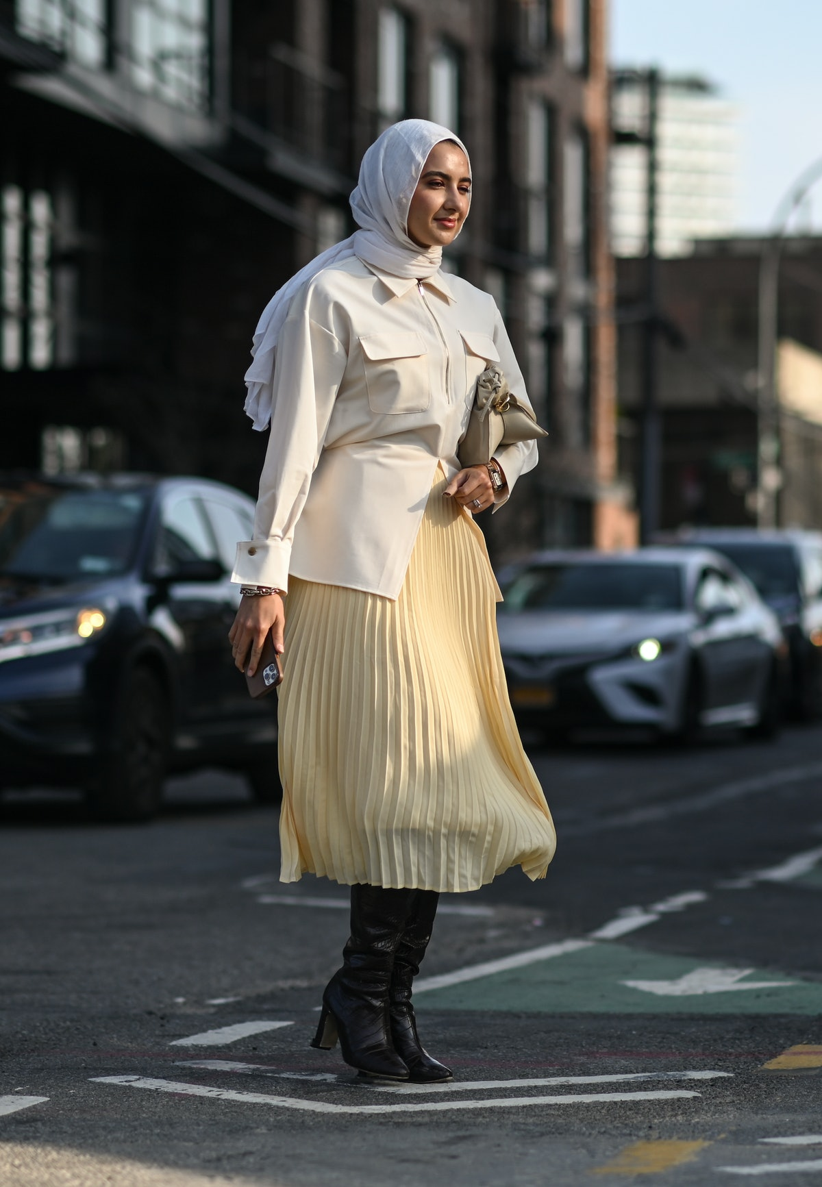 Tall boots worn with a midi skirt.